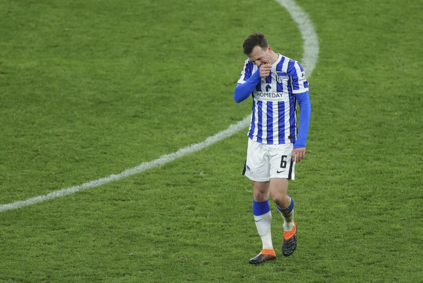 FILE - In this March 13, 2021 file photo, Hertha's Vladimir Darida leaves the field of play after receiving a red card during the German Bundesliga soccer match between Dortmund and Berlin Hertha, in Dortmund, Germany. Hertha Berlin has dropped where no one at the club imagined it could be at the beginning of the season – down to the Bundesliga's relegation zone. (Friedemann Vogel/Pool via AP)