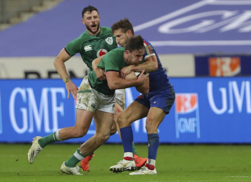 Ireland's Hugo Keenan, left is tackled by France's Vincent Rattez during the Six Nations rugby union international match between France and Ireland in Paris, France, Saturday, Oct. 31, 2020. (AP Photo/Thibault Camus)