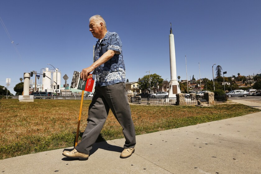 Eddie Morin, 75, son of Raul Morin, walks around the veterans' memorial at a five-point intersection in Boyle Heights.