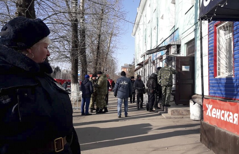Police secure an area Nov. 14 at a college in Blagoveshchensk, Russia, where one student killed another and wounded three more.