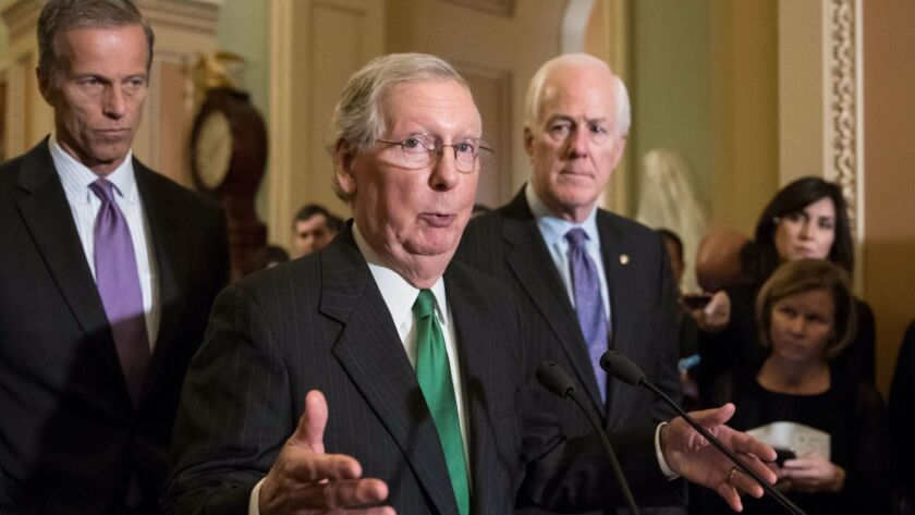 Senate Majority Leader Mitch McConnell (R-Ky.) is flanked by Sen. John Thune (R-S.D.), left, and Majority Whip John Cornyn (R-Texas).