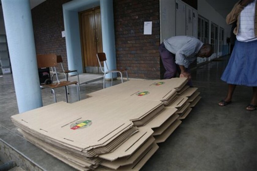 Workers from the Zimbabwe Electoral Commission  sort  material for use as polling booths in  Harare, Thursday, March, 14, 2013. The country is set to hold  a referendum  on Saturday  in  which people are expected to vote  for the adoption of the  draft constitution as the country prepares to hold e