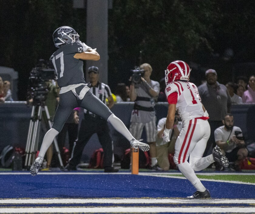 Although Logan Loya makes a touchdown catch for St. John Bosco, it was Mater Dei and Joshua Hunter who prevailed in a battle of the top two teams in the Southland on Oct. 25, 2019.