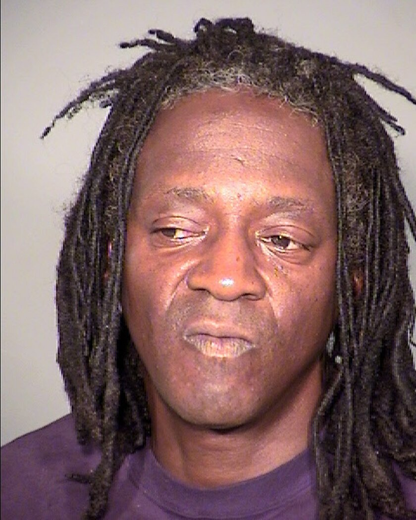 This undated booking photo provided by the Clark County Detention Center shows William Drayton Jr. aka Flavor Flav after his arrest in Las Vegas. Authorities say they arrested the entertainer shortly after midnight on Thursday, May 21, 2015, in Las Vegas for driving under the influence, speeding, possessing less than an ounce of marijuana and having an open container of alcohol in the 2005 black BMW he was driving. (Clark County Detention Center via AP)