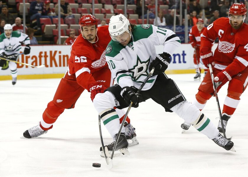 Detroit Red Wings defenseman Jonathan Ericsson (52) defends Dallas Stars left wing Patrick Sharp (10) in the first period of an NHL hockey game, Sunday, Nov. 8, 2015 in Detroit. (AP Photo/Paul Sancya)