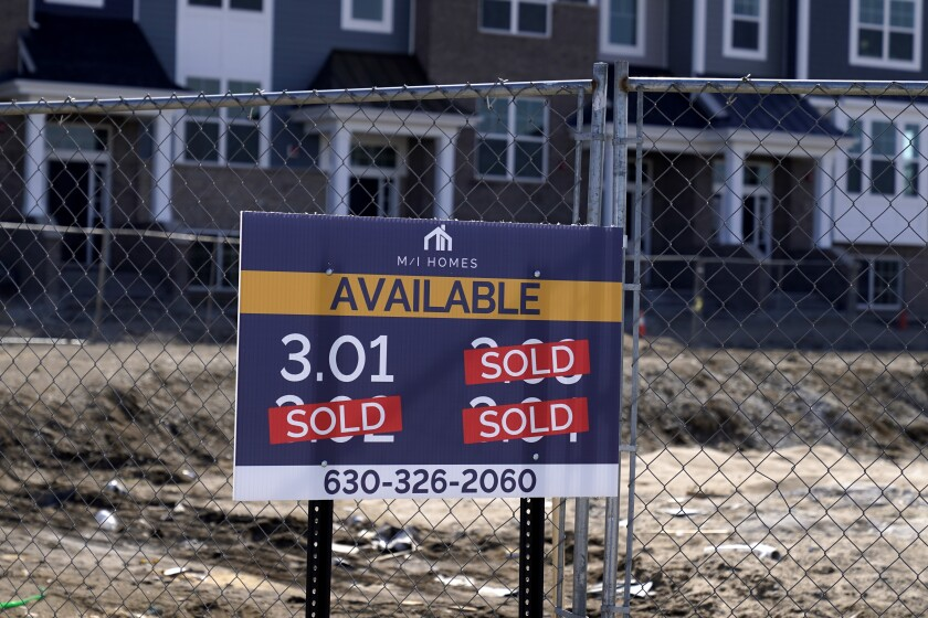 """""""Sold"""" signs are seen on a lot as new home construction continues in a new development in Northbrook, Ill., Sunday, March 21, 2021. On Thursday, May 13, 2021, Freddie Mac reported that mortgage rates declined during the week, marking their fourth consecutive week below 3% and further evidence of the strength in the economy's recovery from the pandemic recession. (AP Photo/Nam Y. Huh)"""