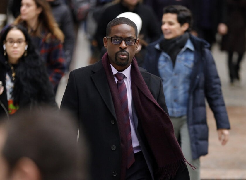 """This image released by NBC shows Sterling K. Brown in a scene from """"This Is Us."""" Season five debuts Tuesday and will address the pandemic and Black Lives Matter movement. (Will Hart/NBC via AP)"""