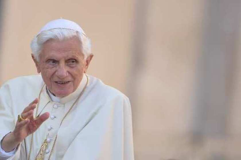 Pope Benedict XVI arrives for his weekly general audience at St. Peter's square on Wednesday at the Vatican.