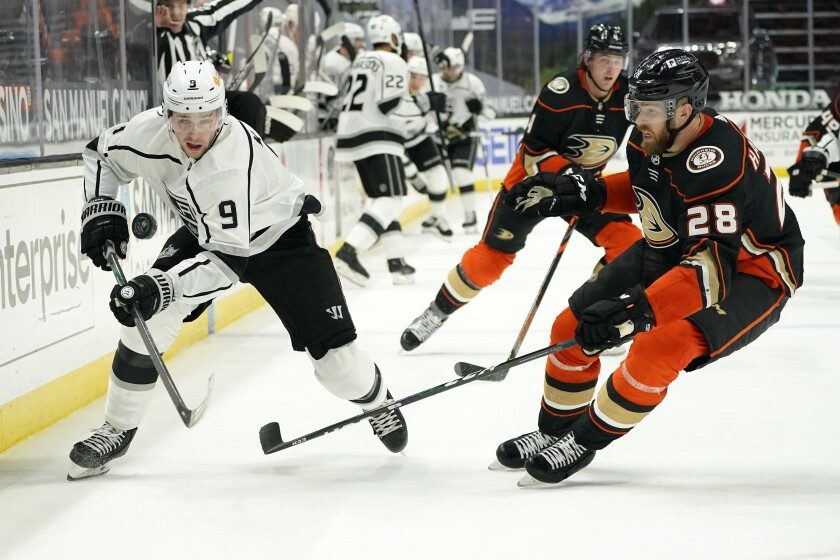 Kings and Ducks players on the ice