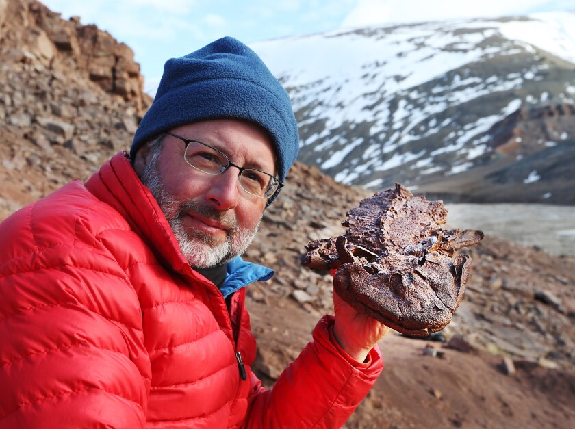 """Neil Shubin with Tiktaalik Fossil in a photo from PBS' """"Your Inner Fish."""" Credit: Tangled Bank Studios/PBS"""