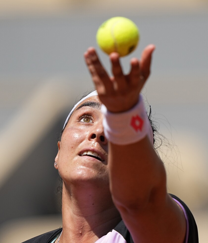 Tunisia's Ons Jabeur serves to United States's Coco Gauff during their fourth round match on day 9, of the French Open tennis tournament at Roland Garros in Paris, France, Monday, June 7, 2021. (AP Photo/Michel Euler)