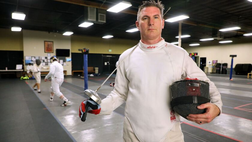 Retired Marine Creston Bailey finds time to practice his fencing skills about four times a week.