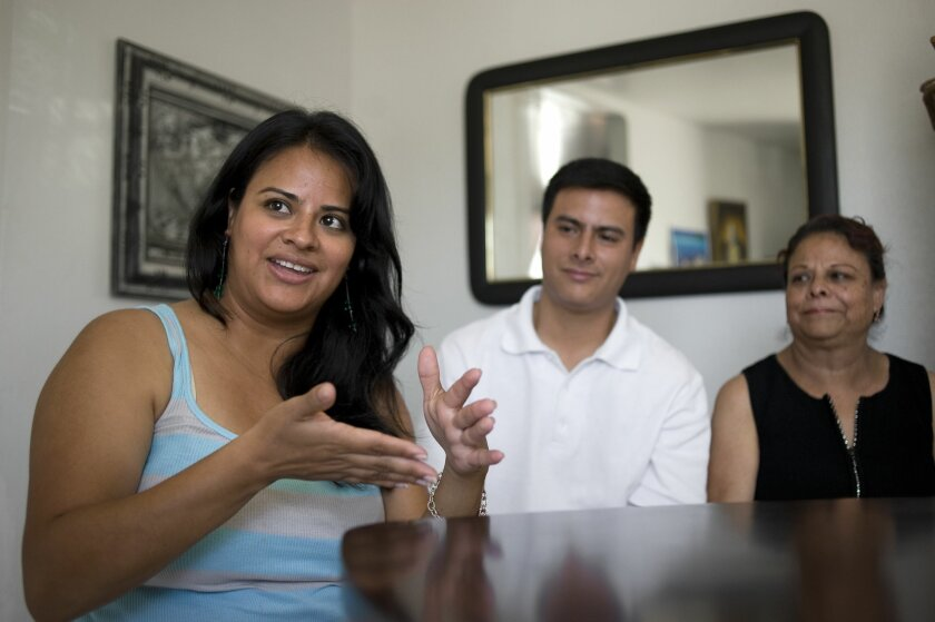 Nancy Landa talks about her plans for the future as her brother William and mother Lourdes listen.