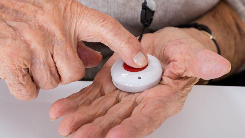 Senior Woman Pressing Alarm Button