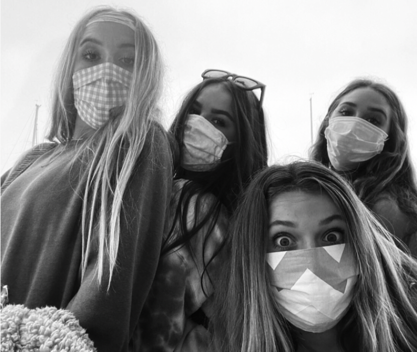 Photography students at Carlsbad High in self-portrait with masks on