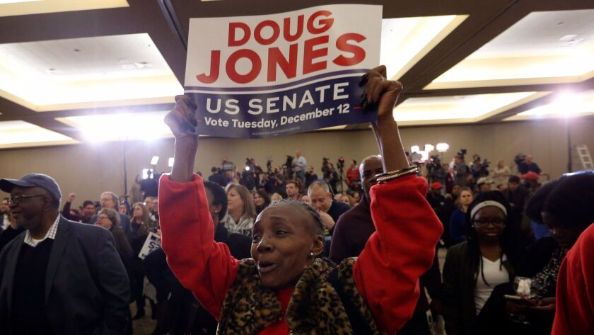 Supporters of Doug Jones wait for results during an election-night watch party in Birmingham , Ala., on Dec. 12.
