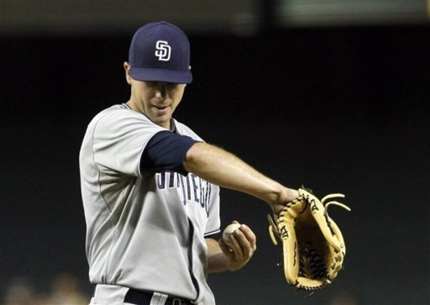 San Diego Padres' Wade LeBlanc pauses on the mound as he gives up four runs to the Arizona Diamondbacks in the first inning in a baseball game on Friday, Aug. 26, 2011, in Phoenix. (AP Photo/Ross D. Franklin)