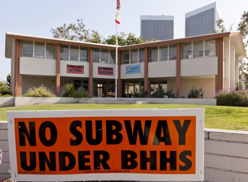 Signs opposing a subway tunnel construction planned under Beverly Hills High School are seen here posted at the district offices in 2012. The district superintendent disagrees with a judge's recent decision clearing the way for the project.