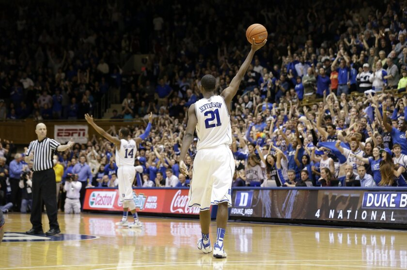 Duke's Amile Jefferson (21) and Rasheed Sulaimon (14) celebrate near the end of an NCAA college basketball game against Maryland in Durham, N.C., Saturday, Feb. 15, 2014. Duke won 69-67. (AP Photo/Gerry Broome)