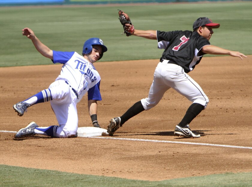 Photo by www.andrewfoulkphotography.com Temescal Canyon's Josh Cohen, slides in safe at third as Lake Elsinore's Evan Hartfiel, throws to first for an out during the 1st inning at the Lake Elsinore Diamond on Friday.