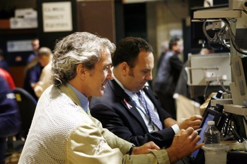 In this Sept. 1, 2010 photograph, traders and specialists work the trading floor of the New York Stock Exchange, in New York. (AP Photo/David Karp)