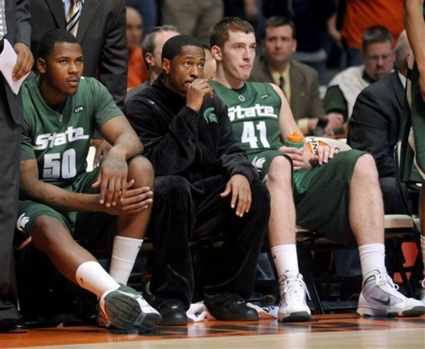 Michigan State's Kalin Lucas (1) watches the game against Illinois as teammates Derrick Nix (50) and Garrick Sherman (41) look on during the first half of an NCAA college basketball game at the Assembly Hall in Champaign, Ill on Saturday, Feb. 6, 2010. (AP Photo/Heather Coit)