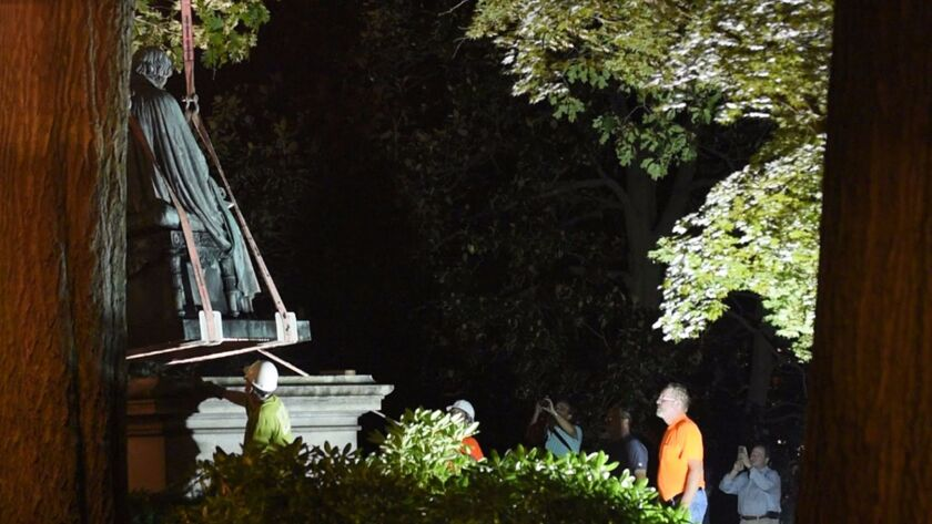 Crews slowly remove the statue of former Justice Roger Taney from the front lawn of the Maryland State House in Baltimore on Aug. 17.