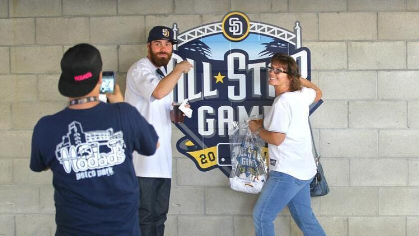 Baseball fans will get a whole lot more to do than pose for pictures with the MLB All-Star Game logo starting this weekend. The game will be played Tuesday, July 12. (John Gastaldo)