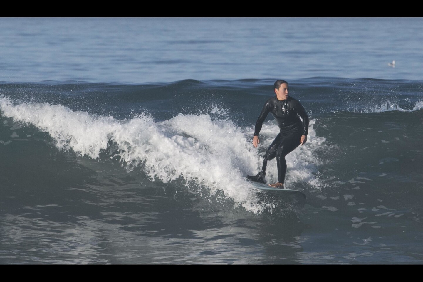 Dani caught a wave at the beach in Encinitas.