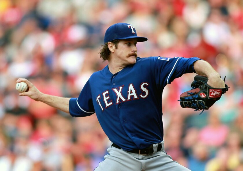 Texas Rangers starting pitcher Miles Mikolas delivers in the first inning of a baseball game against the Cleveland Indians Saturday, Aug. 2, 2014, in Cleveland. (AP Photo/Aaron Josefczyk)