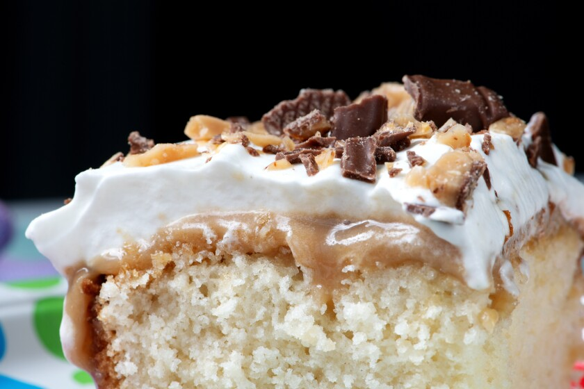 Cover your cake in candy bars and whipped cream for the best frosting