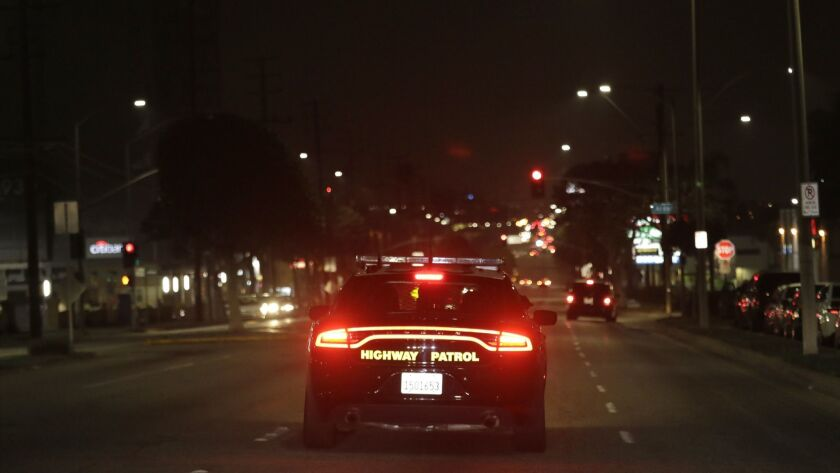 LOS ANGELES, CA -- JUNE 03, 2018: A car with the California Highway Patrol looks for street racers i