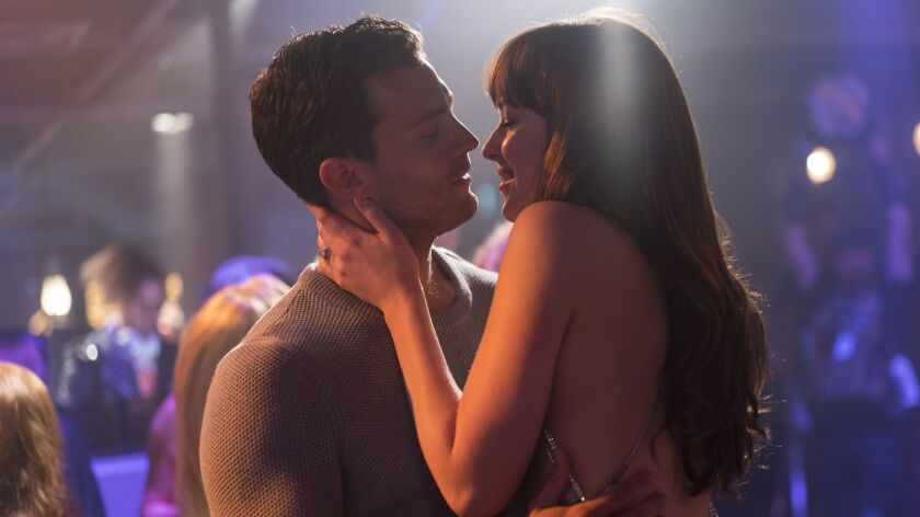 "(L-R) - JAMIE DORNAN and DAKOTA JOHNSON return as Christian Grey and Anastasia Steele in ""Fifty Shad"