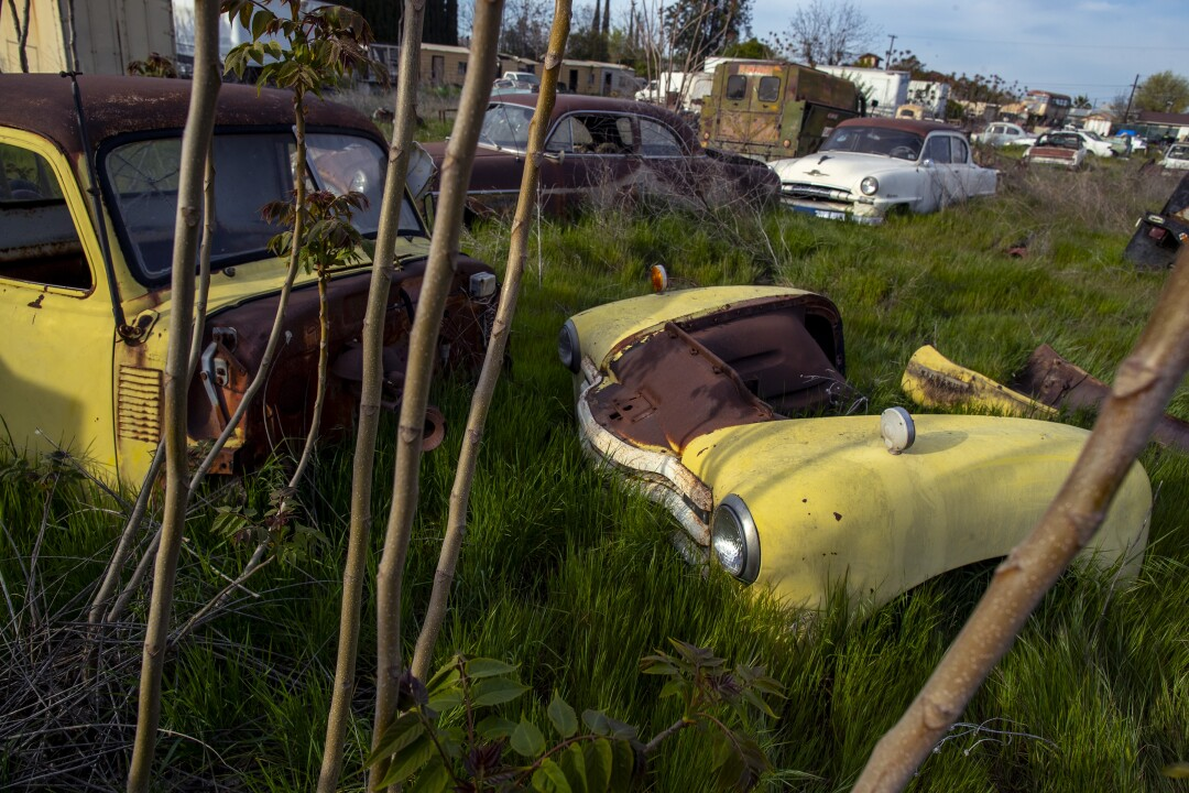 Old cars, junk and antiques on a lot in Turlock.
