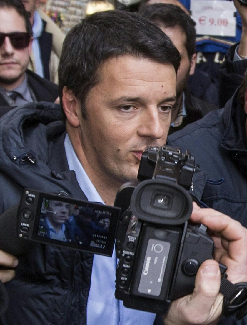Democratic Party secretary Matteo Renzi arrives to speak at a party leadership meeting to decide whether to yank support from Letta's fragile coalition government, accusing the premier of failing to make progress on key financial reforms, in Rome Thursday, Feb. 13, 2014. Italian Premier Enrico Letta faces a new challenge to his leadership Thursday as the head of his own party tried to orchestrate a power grab. Renzi, 39, has been critical of Letta since December, when Renzi was voted head of their Democratic Party. If successful, Renzi could be tapped to form a new government. (AP Photo/Roberto Monaldo) ITALY OUT