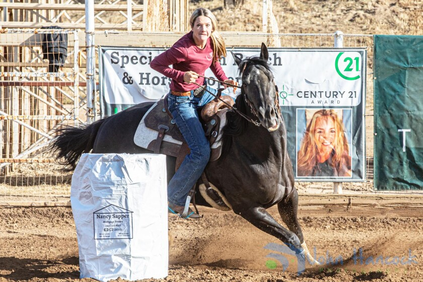 PVRA member Rebecca Arnold competes in a barrel racing event at the PVRA grounds.