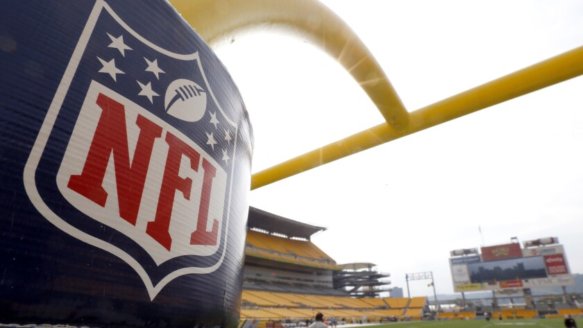 The NFL shield logo is displayed on a field goal post at Heinz Field in September 2013.