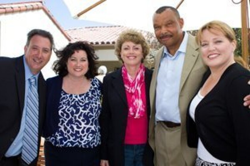 From left: Kathy Karpe of Casa de Amparo and Paul Mittermeier, Ed Block Foundation, with Jeanne Bonk, James Collins and Kimberley Layton of the San Diego Chargers