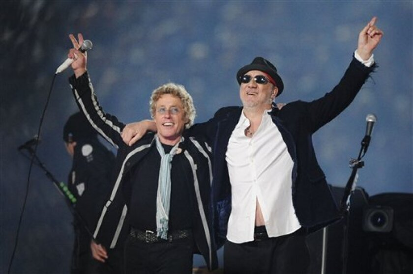 """FILE - In this Feb. 7, 2010 file photo, Roger Daltrey, left, and Pete Townshend acknowledge the crowd after performing during the second half of the NFL Super Bowl XLIV football game in Miami. Daltrey and Townshend are taking """"Quadrophenia"""" and other Who classics on the road for a U.S. tour in fall"""