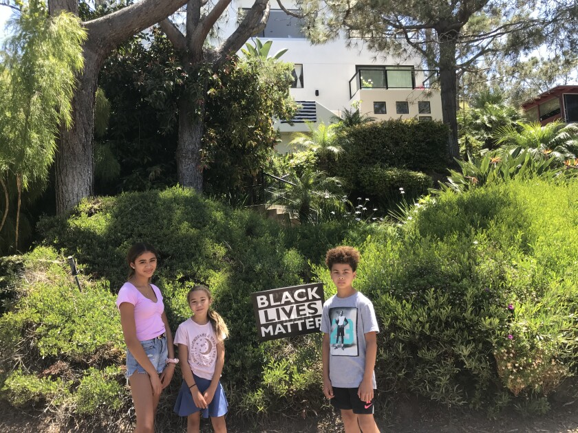 Del Mar resident Nicole Forrest and her three children have helped support the Black Lives Matter cause locally.
