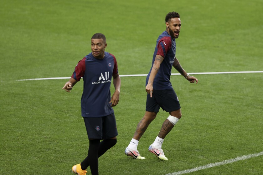 PSG's Kylian Mbappe and Neymar, right, gesture during a training session at the Luz stadium in Lisbon, Tuesday Aug. 11, 2020. PSG will play Atalanta in a Champions League quarterfinals soccer match on Wednesday. (Rafael Marchante/Pool via AP)