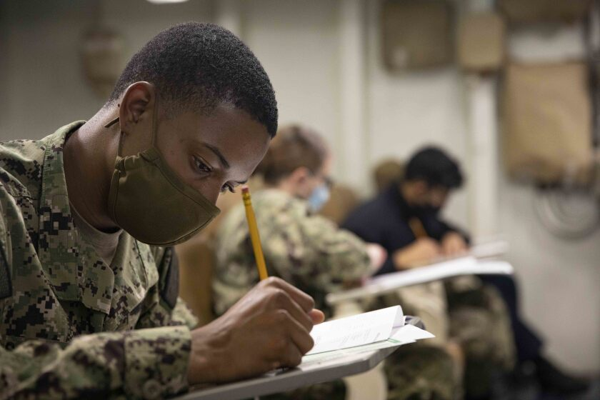 Retail Specialist 3rd Class Dadrien Sampleton takes the Navy advancement exam in September.