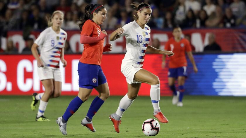 United States' Alex Morgan, right, during the first half of an international friendly soccer match a