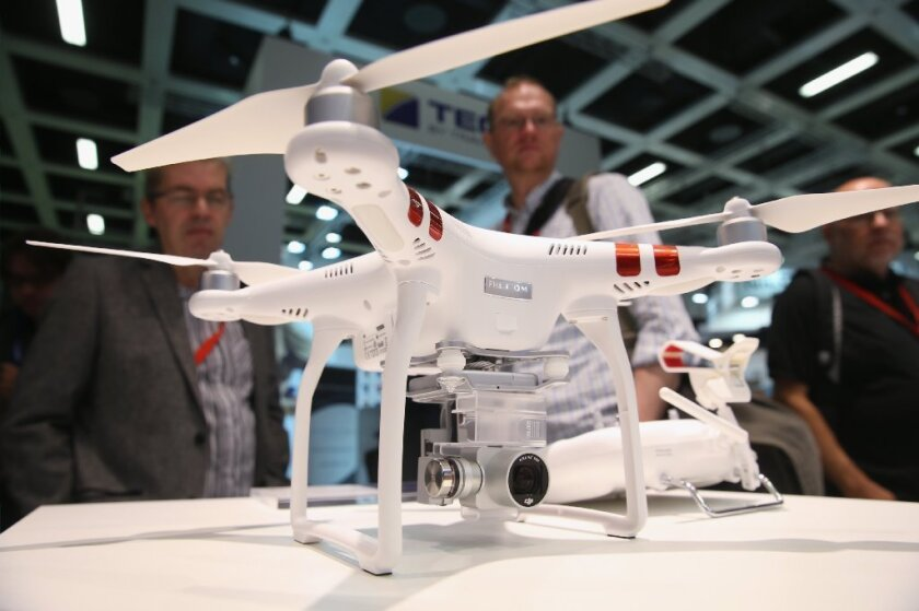 Visitors look at a Phantom 3 Standard quadcopter drone at the 2015 IFA electronics and appliances trade fair on Sept. 3, 2015, in Berlin.