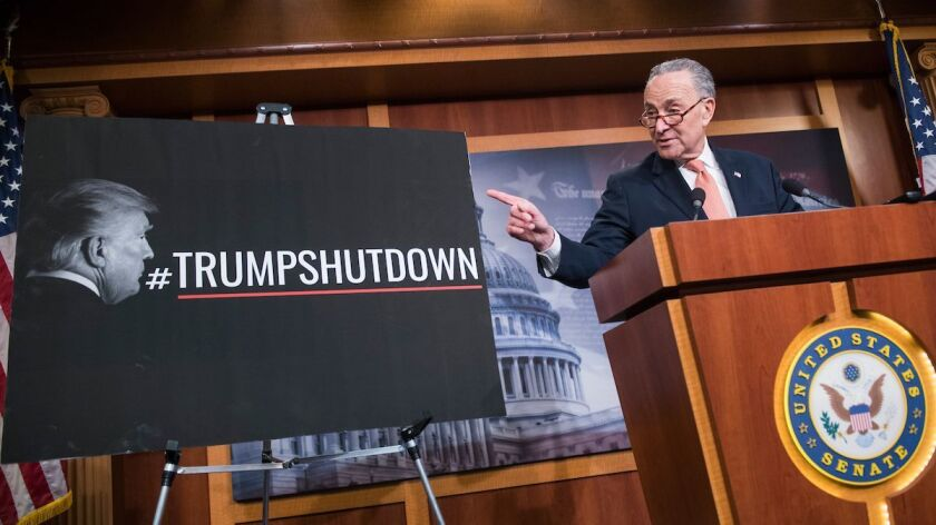 Senate Minority Leader Charles Schumer blames Republicans for the government shutdown Saturday at the U.S. Capitol.