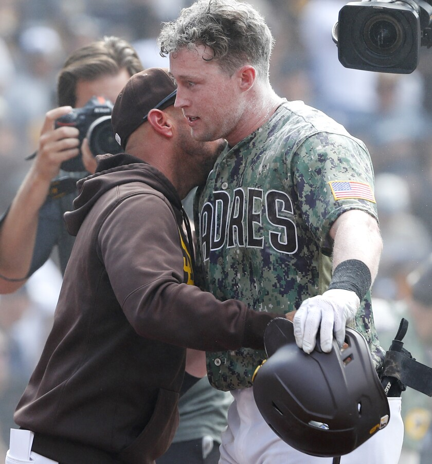 Padres manager Jayce Tingler hugs Jake Cronenworth after he hit a walk-off home run