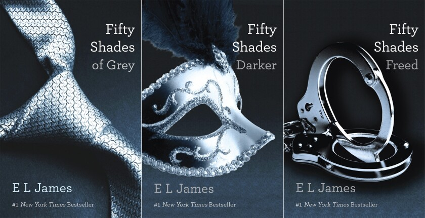 """This combination of cover images released by Vintage shows """"Fifty Shades of Grey,"""" """"Fifty Shades Darker,"""" and """"Fifty Shades Freed,"""" by EL James. Anne Messitte, longtime head of the Vintage and Anchor paperback imprints, who helped make E L James' """"Fifty Shades of Grey"""" a phenomenon, is leaving the company. She is widely credited with spotting the potential of James' explicit fiction, acquiring the """"Fifty Shades"""" trilogy when it was just catching on as a digital release. The books have since sold more than 100 million copies. (Vintage via AP)"""