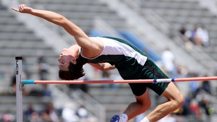 Edison High school athlete Aiden Garnett participates, in the boys high jump event, at the CIF SS Ma