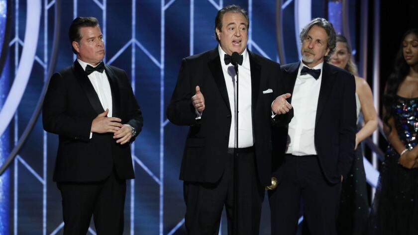 """""""Green Book"""" co-writers Brian Currie, left, and Nick Vallelonga and director Peter Farrelly accept the screenplay award at the 76th Golden Globe Awards on Jan. 6."""