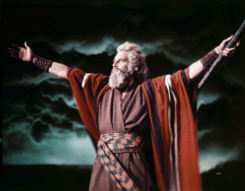 "Charlton Heston as Moses raises his arms in ""The Ten Commandments"""